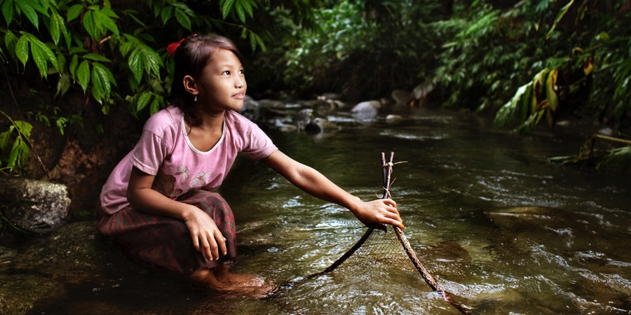 Mentawai girl by river